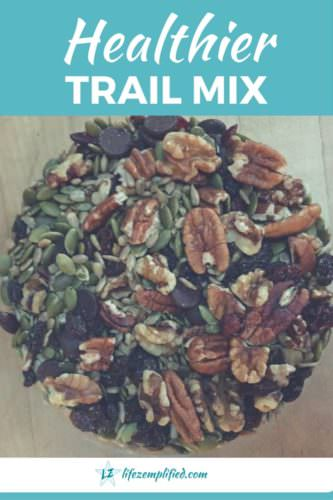 Healthier homemade trail mix with nuts, seeds, dried fruits, and dark chocolate.