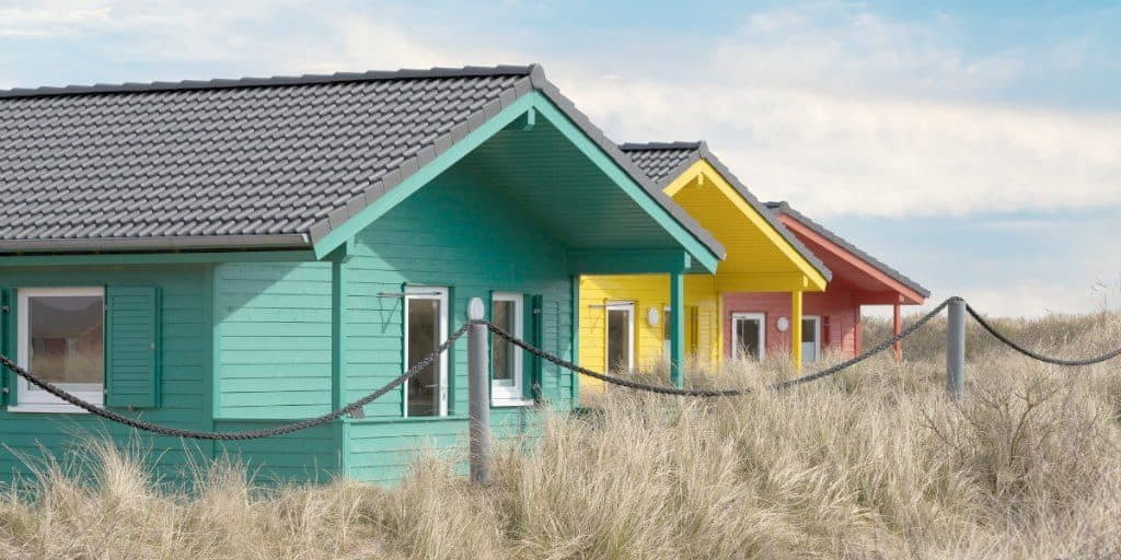 3 colorful cozy cottages in a row